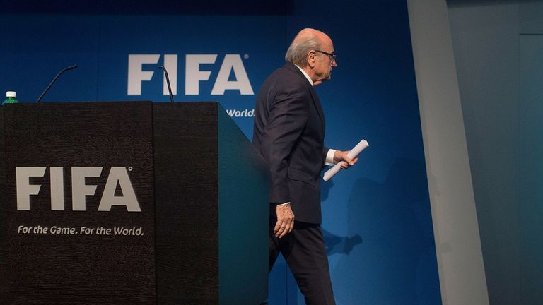 Sepp Blatter walks off the stage following the announcement