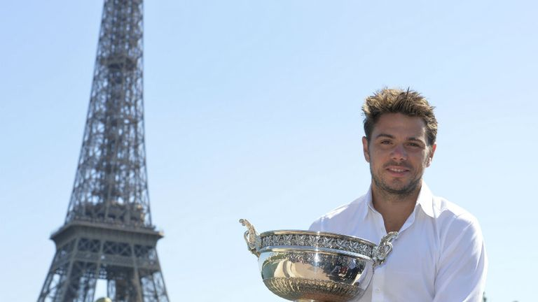 Stan Wawrinka poses with his Musketeers trophy in front of the Eiffel Tower in Paris