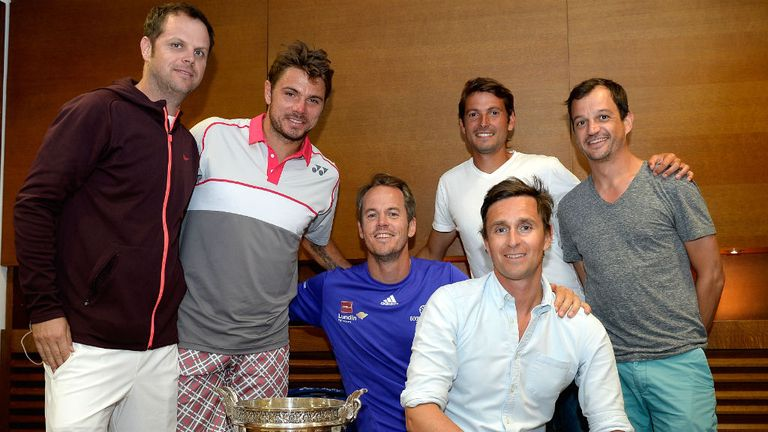 Stan Wawrinka poses with his team after winning in Paris