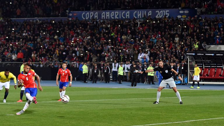 Arturo Vidal score Chile's first from the penalty spot