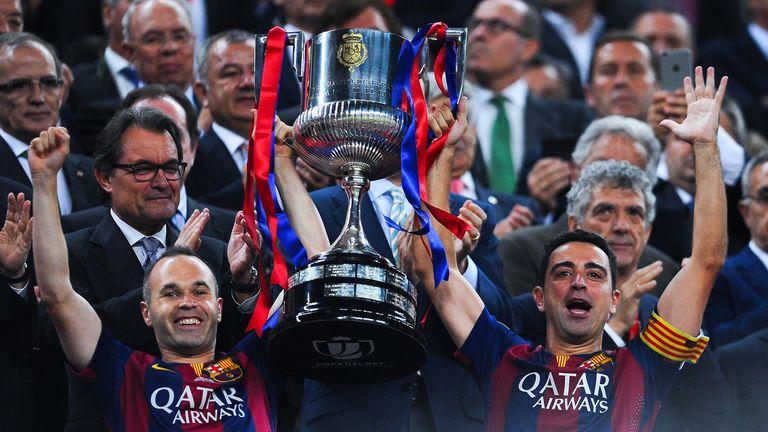 Iniesta (L) and Xavi jointly celebrate Barca's Copa del Rey triumph last season