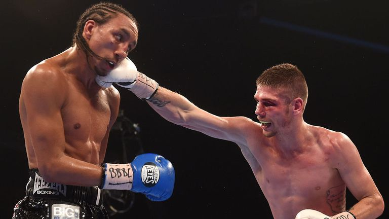 Welshman Chris Jenkins, who suffered a cut above his left eye in the fourth round, lands a right on Tyrone Nurse