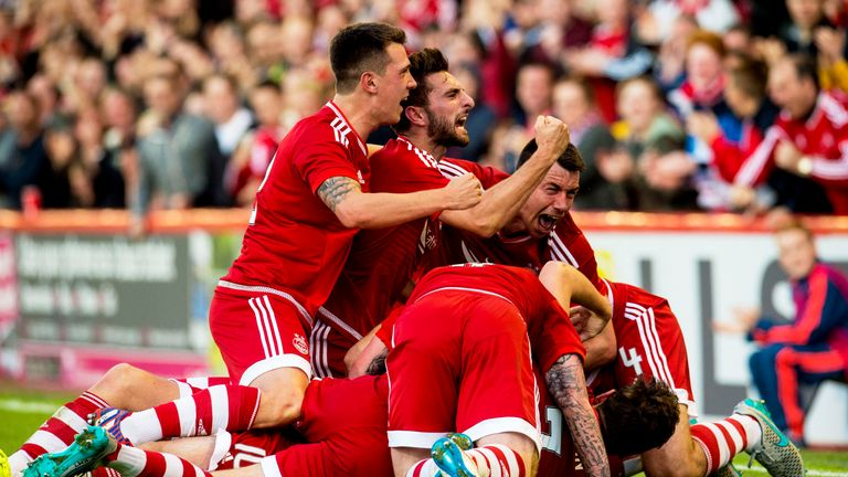 Aberdeen, pictured celebrating Niall McGinn's goal, came back from the brink of an embarrassing collapse