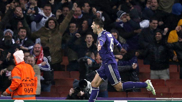 Aleksandar Mitrovic celebrates scoring his team's third goal against Arsenal in the Champions League