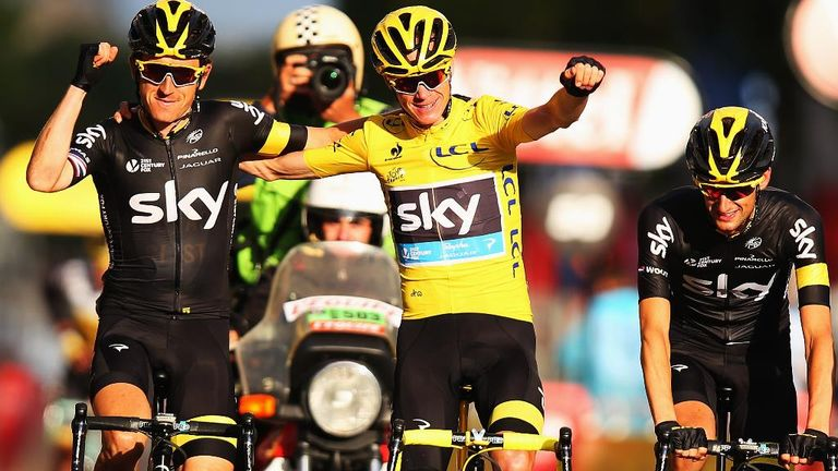 Chris Froome celebrates with Geraint Thomas (left) and Wout Poels (right) as he crosses the finish line in Paris