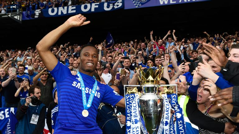 Didier Drogba celebrates Chelsea's title win at a full Stamford Bridge