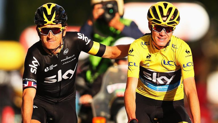 Froome (right) crosses the finish line on the Champs-Elysees alongside Geraint Thomas to complete a second Tour win