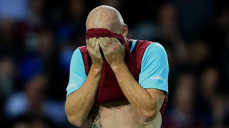 West Ham's James Collins leaves the field dejected after being sent off.