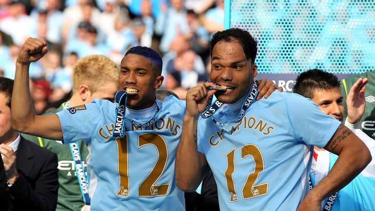 Joleon Lescott celebrates with Gael Clichy after winning the Premier League