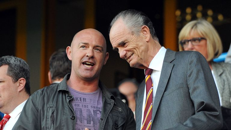 Jon Sharp (left)  - who looks set to become Featherstone coach - talks to Huddersfield Giants chairman Ken Davy
