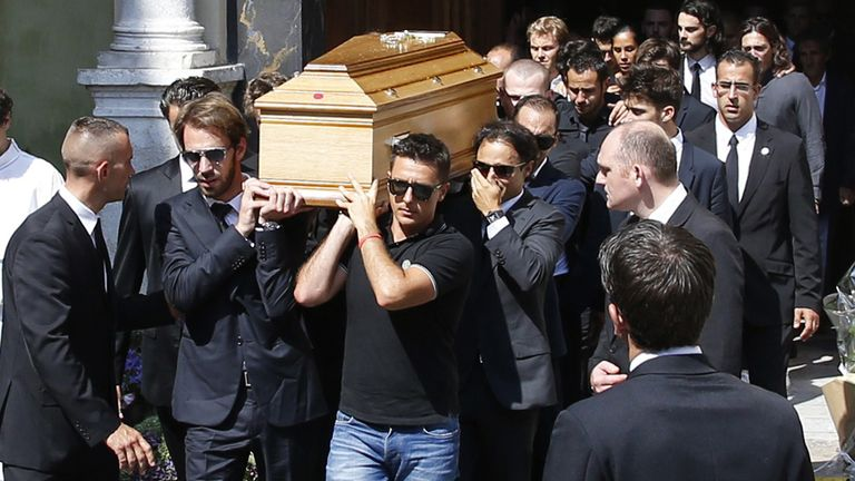 Jules Bianchi's coffin is carried from his funeral ceremony in Nice