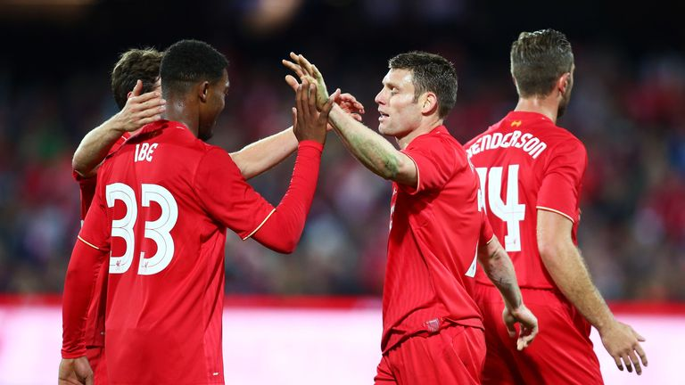 James Milner celebrates with Jordan Ibe after scoring Liverpool's opener