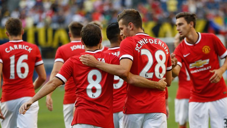 Juan Mata and Morgan Schneiderlin celebrate against Club America
