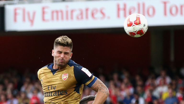 Giroud heads Arsenal in front against Lyon