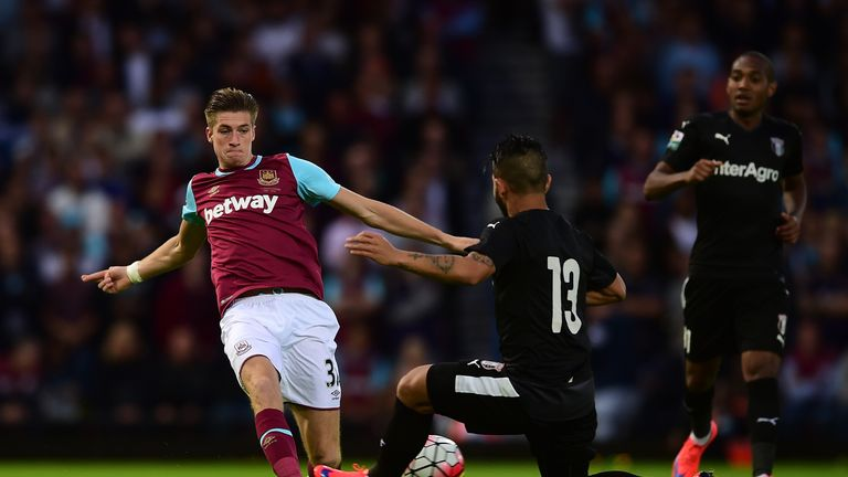 Reece Burke of West Ham battles for the ball against FC Astra.