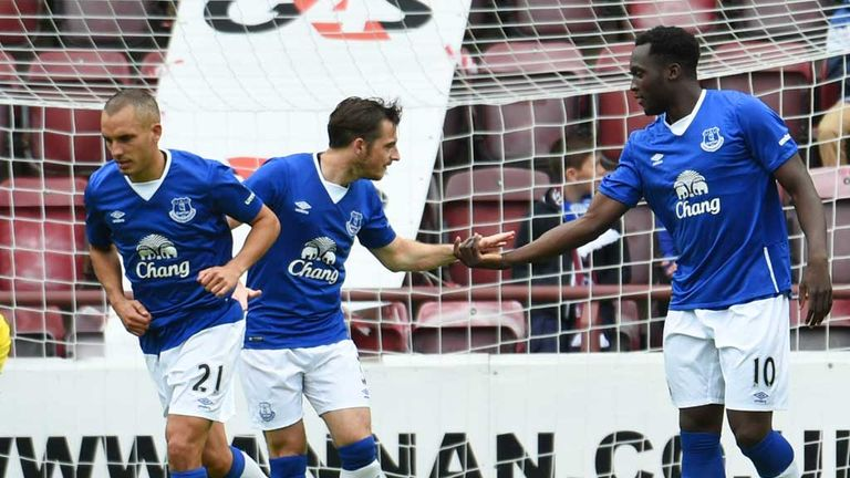 Leon Osman and Leighton Baines congratulate Romelu Lukaku after he completes his hat-trick against Hearts.