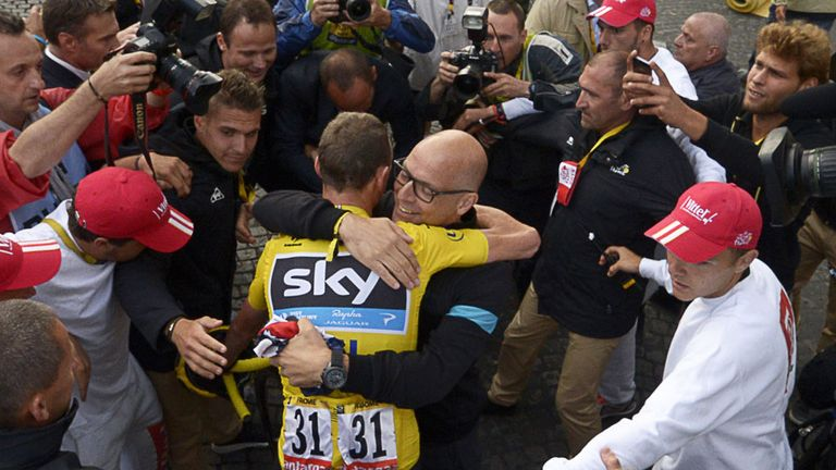 Sir Dave Brailsford and Chris Froome celebrate Tour de France success