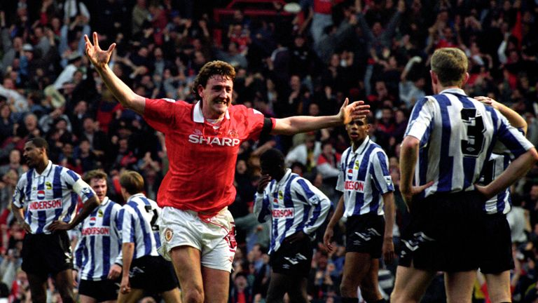 Steve Bruce celebrates his second goal for Manchester United against Sheffield Wednesday in April 1993