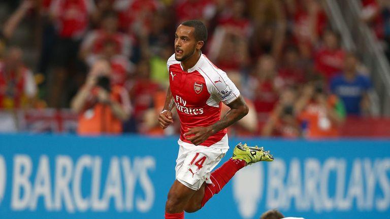 Theo Walcott celebrates scoring Arsenal's opener