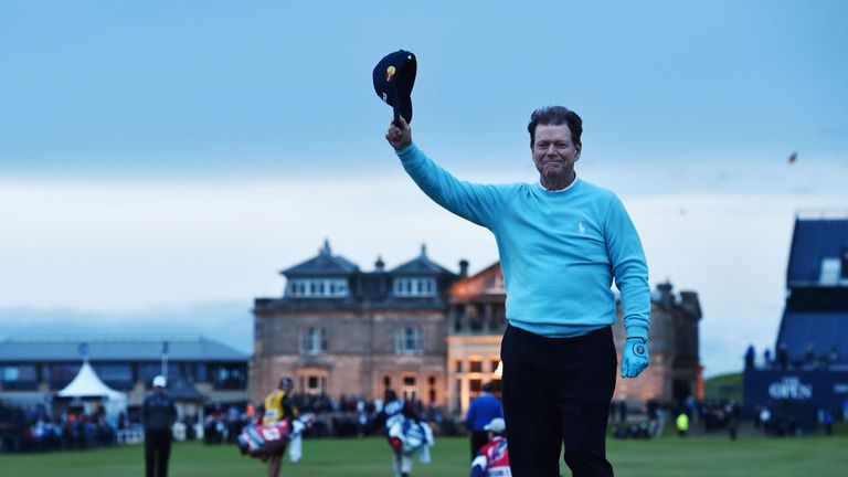Tom Watson waves to the crowd from Swilcan Bridge on his final Open appearance