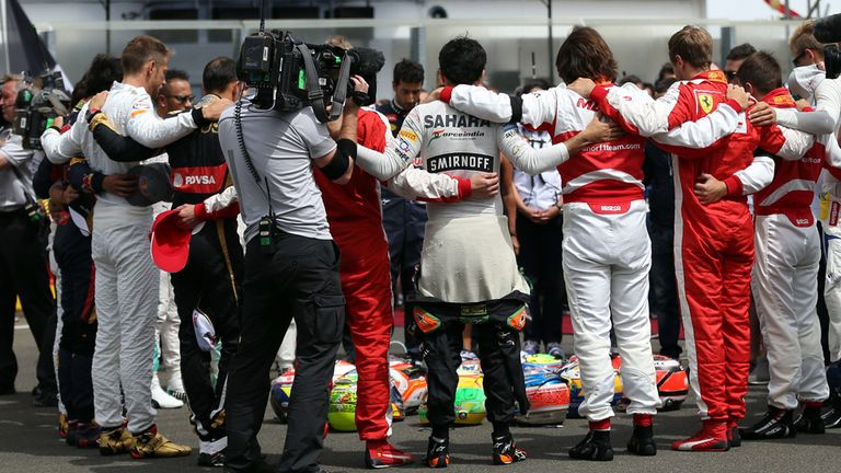Respects are paid to Jules Bianchi on the grid at the Hungarian GP by the F1 drivers