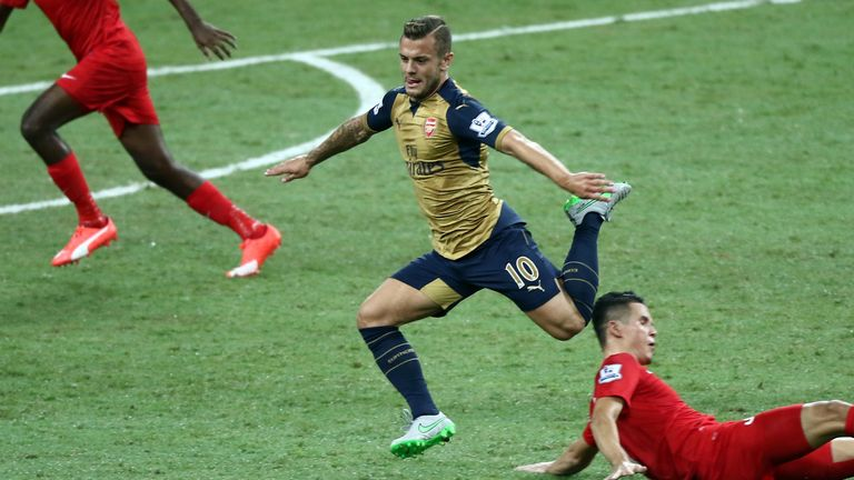 Jack Wilshere skips past a Singapore Select XI midfielder