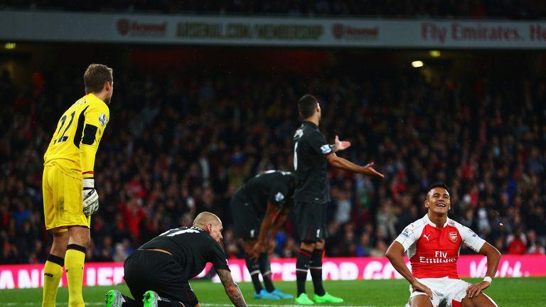 Sanchez reacts after failing to convert a chance