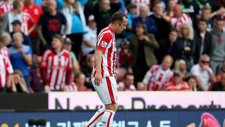 Charlie Adam walks off the pitch after being shown a red card, leaving Stoke down to nine men