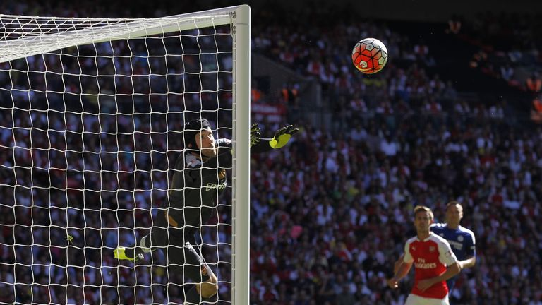 Arsenal goalkeeper Petr Cech (left) makes a save from a free-kick