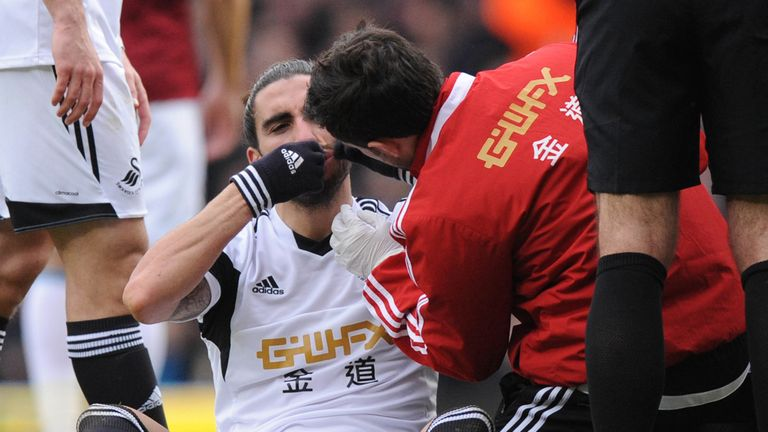 Andy Carroll was sent off after appearing to catch Swansea's Chico Flores with his arm in 2014, but the decision was not overturned despite an appeal. If it had been overturned, Flores would now face a possible FA ban