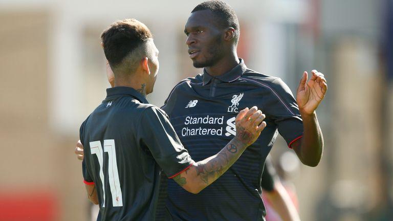 Liverpool's Christian Benteke (right) celebrates his goal against Swindon