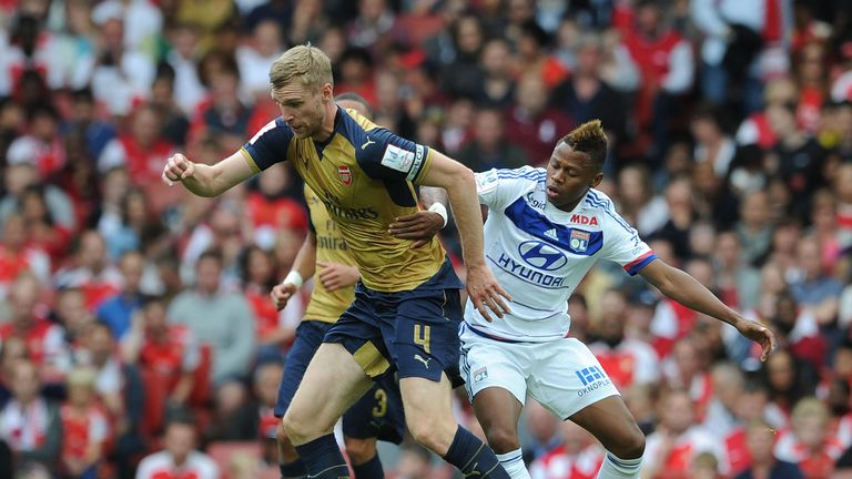 Njie pressurises Arsenal's Per Mertesacker of Arsenal during the recent Emirates Cup
