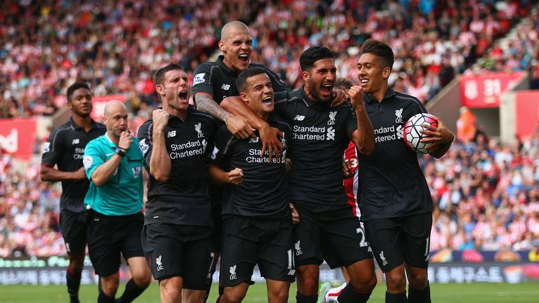 Philippe Coutinho celebrates with team-mates following his stunner at Stoke