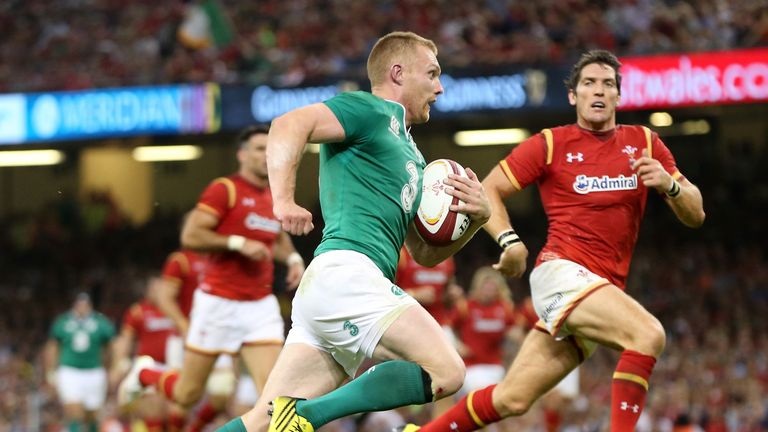 Keith Earls of Ireland breaks away to score a try against Wales