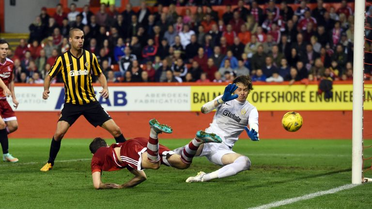 Kenny McLean squeezed a late header inside the post to bring Aberdeen back into the game but they couldn't score again to force extra-time