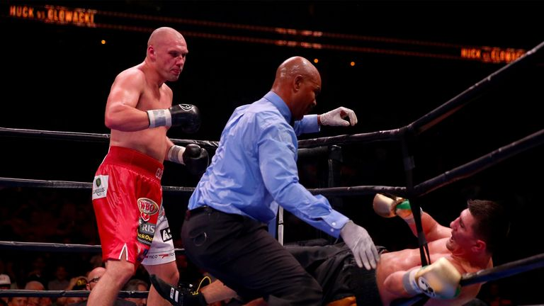 Marco Huck (right) nearly falls out of the ring during his bout with Krzysztof Glowacki