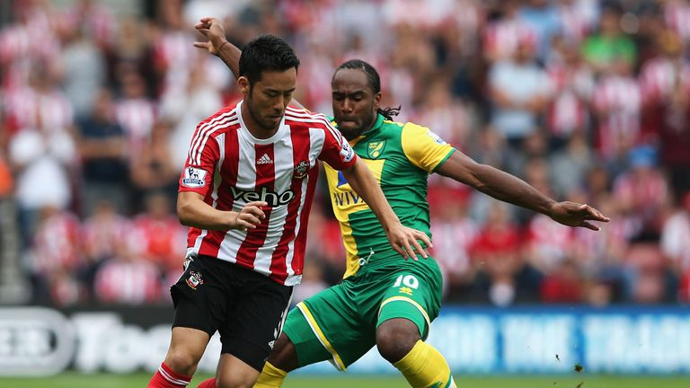 Maya Yoshida (left) is closed down by Cameron Jerome