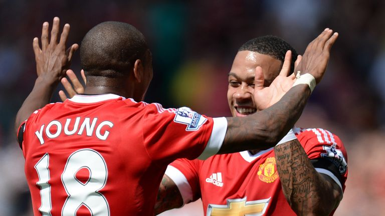 Memphis Depay (right) celebrates with Ashley Young