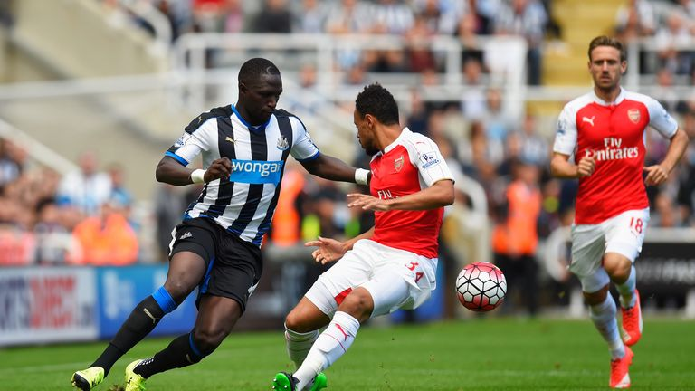 Moussa Sissoko (left) competes for the ball with Francis Coquelin (middle)