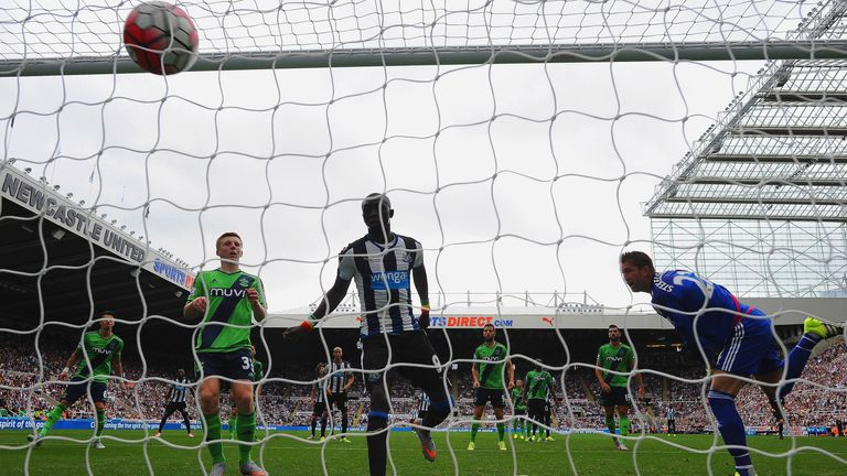 Papiss Demba Cisse scores the equaliser for Newcastle
