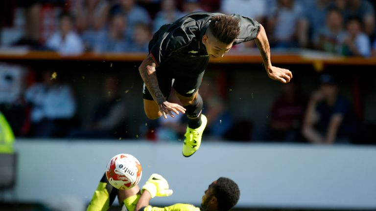 New Liverpool signing Roberto Firmino takes a tumble during the match