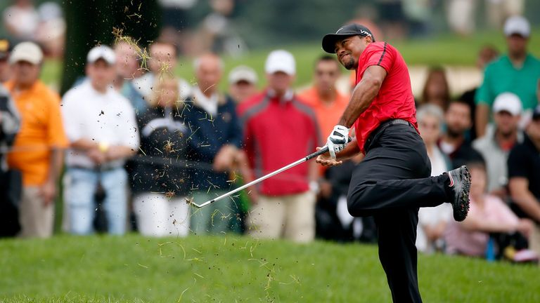 Woods is forced to cut his tournament short at Firestone