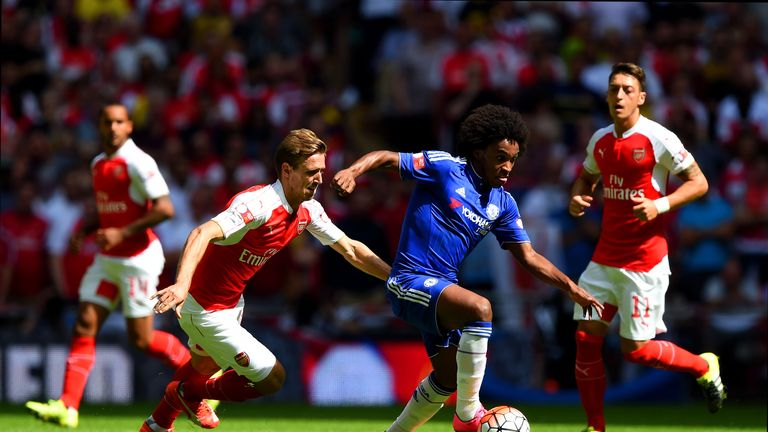 Willian (second right) and Nacho Monreal (second left) compete for the ball