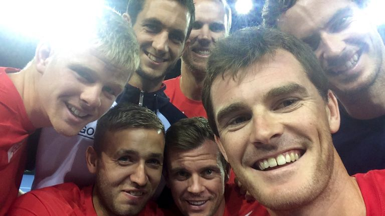 The Great Britain team celebrate in Glasgow after conquering Australia on an emotional Sunday night