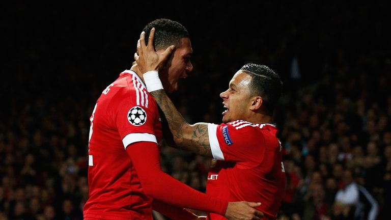Smalling celebrates what would prove his winner with team-mate Memphis