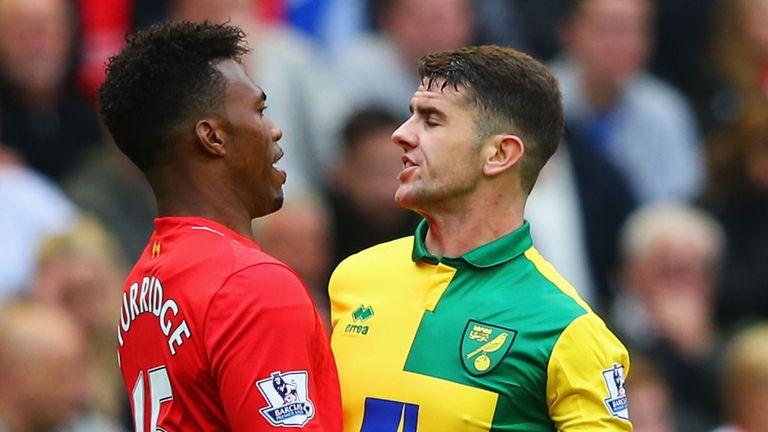Daniel Sturridge of Liverpool and Robbie Brady of Norwich City clash