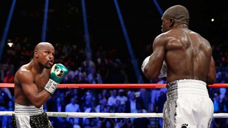 Floyd Mayweather goades Andre Berto during their welterweight showdown in Las Vegas earlier this month