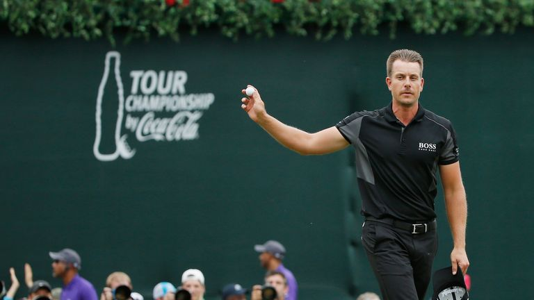 Henrik Stenson salutes the crowd after his spectacular closing birdie