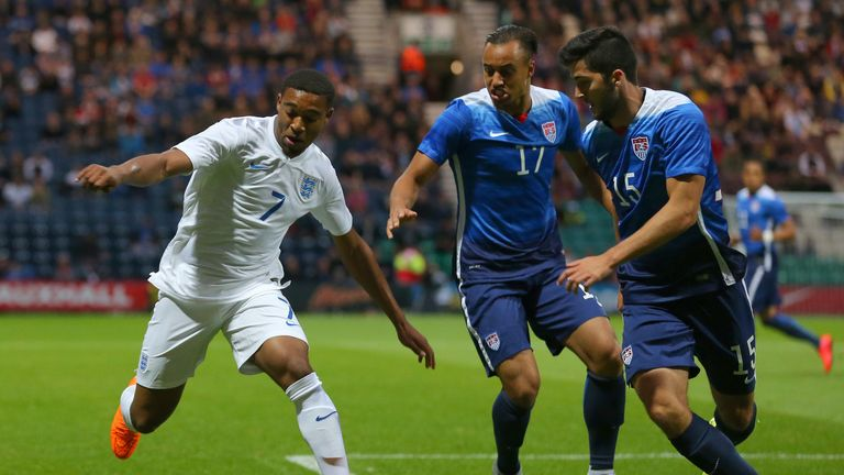 Jordan Ibe (left) takes on USA pair Jerome Kiesewetter (centre) Eric Miller (right) in Preston
