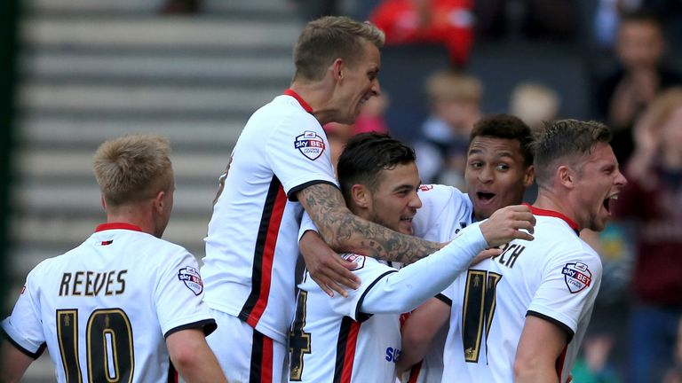Josh Murphy (second right) celebrates scoring against Derby on loan at MK Dons